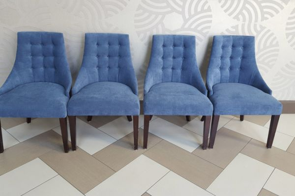 Tufted Accent Chairs in Houston hotel by Elegant Upholstery