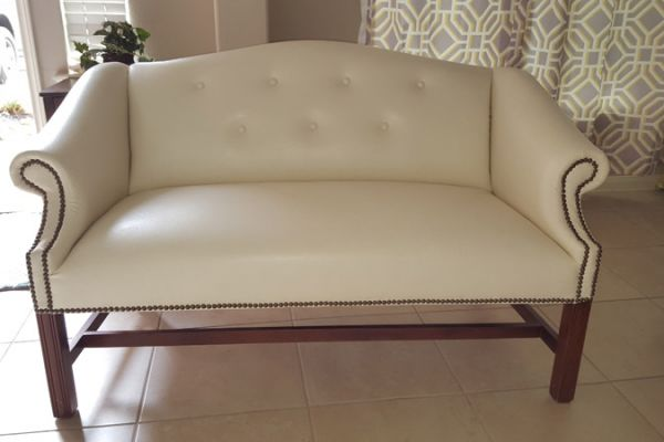 leather Settee upholstery with nailheads by Elegant Upholstery Houston